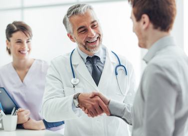 Smiling doctor shaking a patient's hand