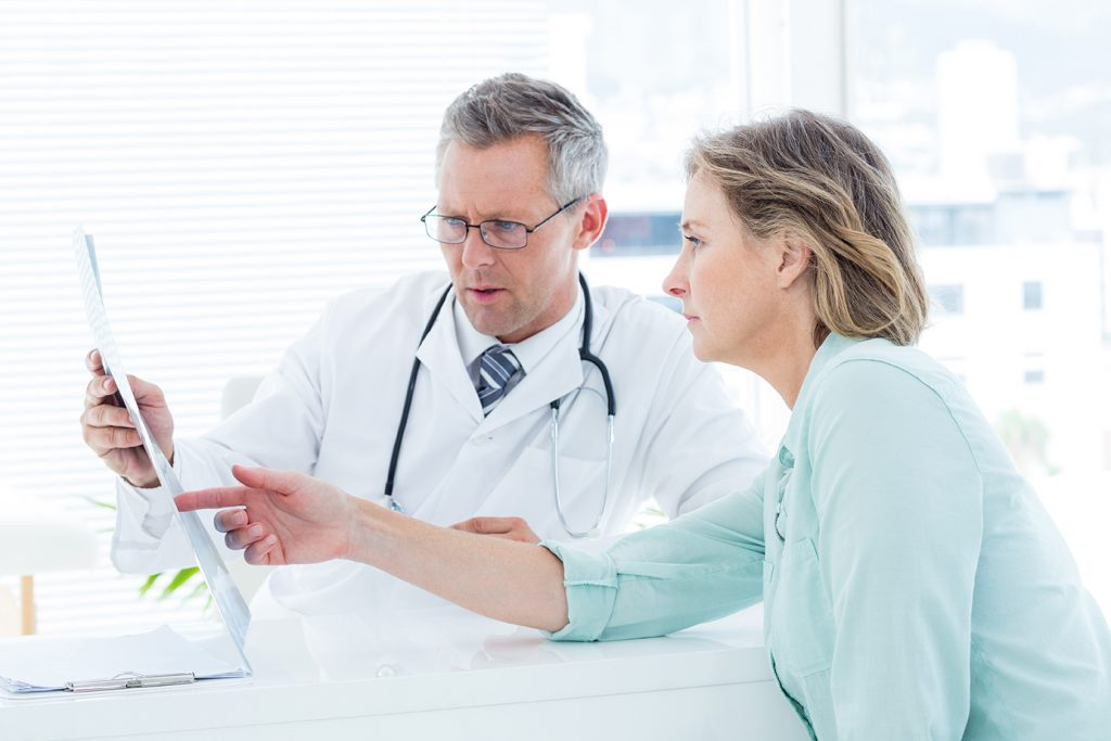 Doctor showing a chart to his patient