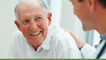smiling patient talking with his doctor