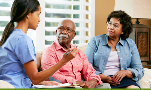 nurse discussing with elderly couple